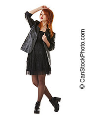 Beautiful red-haired model touts gothic clothing