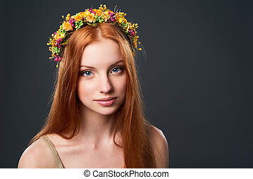 Beautiful red haired woman in flower wreath