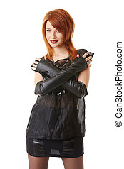 Beautiful red-haired woman in gothic outfit