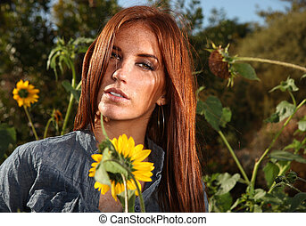 Red Haired Woman Outdoors in a Sunflower Field