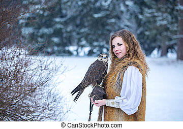 red-haired woman with a falcon