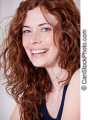beautiful red head woman with freckled face and blue eyes