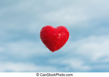 Beautiful red heart with bubbles floating in the air
