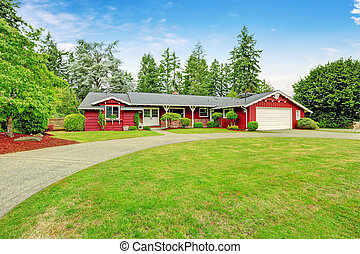 Beautiful red house with garage and curb appeal