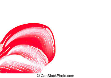 Red lip gloss on a white background close-up.