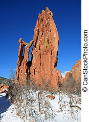 Beautiful red rocks and snow in the Garden of the Gods park, in Colorado