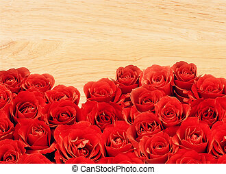 beautiful red rose over wooden table background
