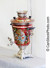 Beautiful red Russian samovar with painted flowers, blue petals