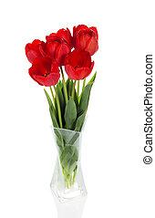 Beautiful red tulips in vase
