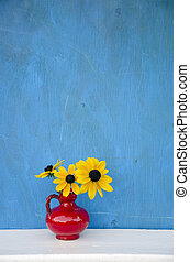 beautiful red vase with yellow flowers