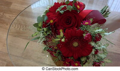 beautiful red wedding bouquet on the transparent table glass