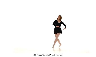 Beautiful red woman ballet dancer isolated on white background, slow motion