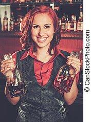 Beautiful redhead barmaid behind bar counter