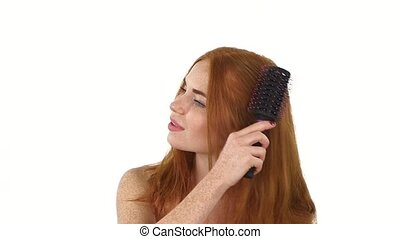 Beautiful Redhead girl Brushing Her Hair. slow motion, close up, bathroom