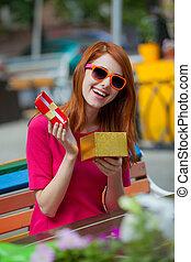 beautiful redhead girl with gift box