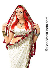 Beautiful Redhead Sexy Woman in Traditional Indian Sari Clothing with Bridal Makeup and oriental jewelry.