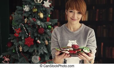 Beautiful Redhead Woman Holding Plate with Cakes