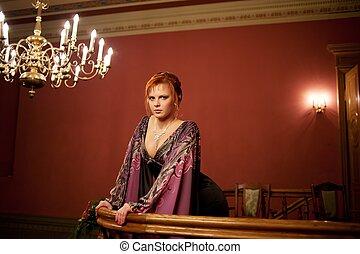 Beautiful redhead woman in evening dress.