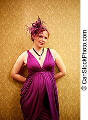 Beautiful redhead woman in purple dress.