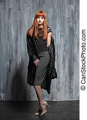 Beautiful redhead woman posing in studio