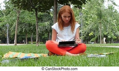 Beautiful Redhead woman with a laptop, slow motion