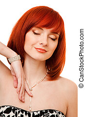beautiful redhead woman with necklace and bracelet