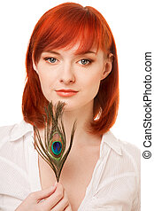 beautiful redhead woman with  peacock feather