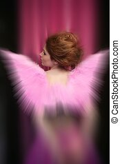 Beautiful redhead woman with pink wings