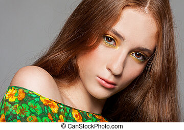 Beautiful redhead woman with stylish colorful makeup