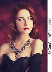 Beautiful redhead women in corset.