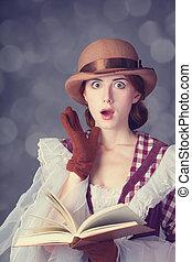 Beautiful redhead women with book.