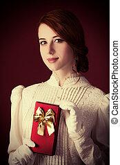 Beautiful redhead women with gift