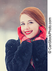 Beautiful redhead women with in winter park.