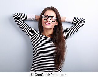 Beautiful relaxing woman in glasses looking up with thinking look