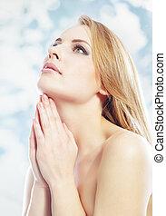 Beautiful religion - Elegant healthy woman praying and...