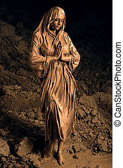 Beautiful religious woman smeared with clay - Fashion...