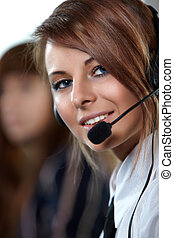 Beautiful representative smiling call center woman with headset.