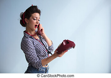 Beautiful retro girl with a phone. Woman in the style of the fifties.