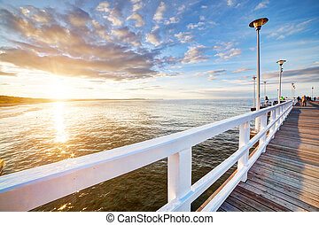 Beautiful retro pier at sunset. Gdansk Brzezno, Poland -...