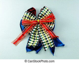 beautiful ribbon bow isolated on gray background
