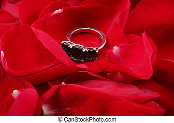 Beautiful ring in petals of red roses