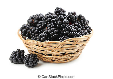 Beautiful ripe blackberry in basket on white background