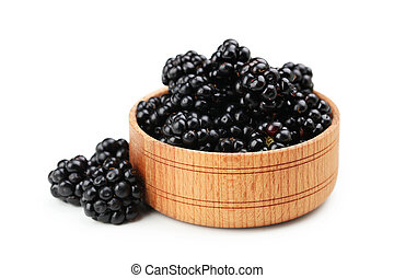 Beautiful ripe blackberry in bowl on white background