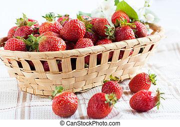 beautiful ripe strawberries in a basket