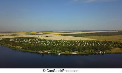 Beautiful River Landscape Aerial View Of Small Village, Drone Shot Of Rural Summer Horizon