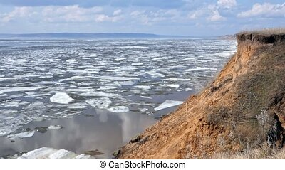 Beautiful river landscape in winter. Ice drifting
