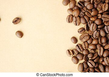 Beautiful roasted coffee beans on yellow background