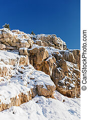 Beautiful rock mountains covered with snow in winter in Uzbekistan in the area of Beldersay resort