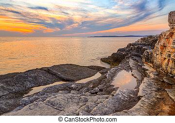 Beautiful rocks and sea. Sunrise over the sea near Rt Kamenjak, Croatia