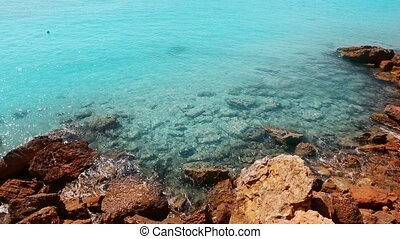 beautiful rocky beach in balearic islands with blue...